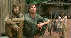 Lost over Laos: Steve Zahn, left, and Christian Bale play American captives.