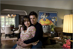 Cross decoration: In the living room, Julie Pinson and Billy Warlock painted the walls, added custom furniture and hung up his vintage French poster.