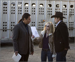 On the case: Holly Hunter, with Gregory Cruz, left, and Bailey Chase, is the title character in Saving Grace.