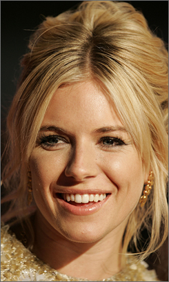 Factory Girl's Sienna Miller has combined forces with Bollywood's biggest movie star to raise global warming awareness throughout India.