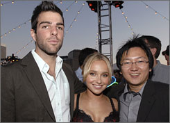 Watch out, he'll brain you!: Zachary Quinto, left, who plays Heroes villain Sylar, tries to keep his hands off co-stars Hayden Panettiere and Masi Oka.