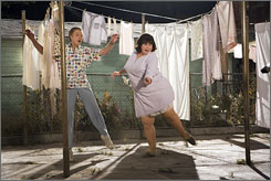 First Pulp Fiction, now this: Christopher Walken, left, and John Travolta sing and dance as husband and wife in Hairspray.