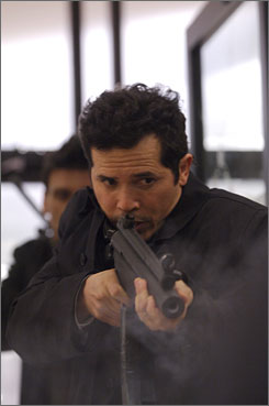Higher-caliber programming: John Leguizamo leads a group of bank robbers in The Kill Point.