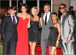 Tom Cruise, Katie Holmes, Jada Pinkett Smith and Will Smith hosted a welcome party for Victoria and David Beckham in Los Angeles Sunday.