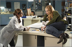 Grace in grave danger: Holly Hunter, right, with Laura San Giacomo, stars as an edgy cop who must delve into spiritual mysteries, not just criminal ones.
