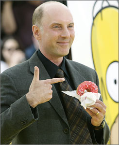 Mmmm, donut: Dan Castellaneta, who has voiced Homer for the past 18 years, enjoys one of his alter ego's beloved pink sprinklies.