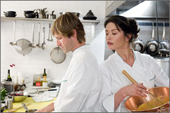 What you got cookin'?: Aaron Eckhart and Catherine Zeta-Jones play kitchen co-workers who develop a romantic bond in No Reservations, a remake of the 2001 German film Mostly Martha.