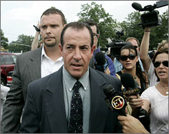 Lindsay Lohan's father Michael Lohan leaves Family Court in Westbury, N.Y.