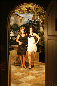 "On the set: Elizabeth Perkins, left, and Mary-Louise Parker star in Weeds, which Perkins calls ""heightened reality."""