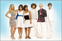 Gang's all here: Ashley Tisdale, Vanessa Hudgens, Monique Coleman, Corbin Bleu, Lucas Grabeel and Zac Efron are hoping to set off a new craze when High School Musical 2 hits Aug. 17.