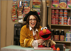 Ahoy there, guest star!: 30 Rock's Tina Fey makes like a pirate with Elmo on Monday's season opener of Sesame Street.