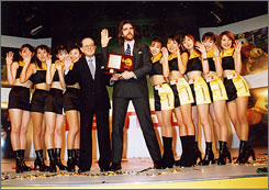 The Pac-Man: Namco's Masaya Nakamura, left, gives Billy Mitchell the Player of the Century award, as seen in The King of Kong.