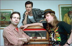 Victor DeLorenzo, left, Gordon Gano and Brian Ritchie of the Violent Femmes were folk-punk favorites in the 1980s. 