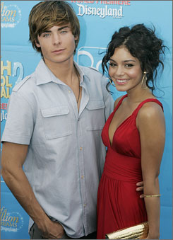 Mixing work with pleasure: Co-stars Zac Efron and Vanessa Hudgens had little to say on the blue carpet about their relationship.