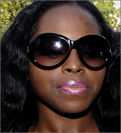 Rapper Foxy Brown is facing a fresh criminal charge after police said she hit her neighbor with her BlackBerry.