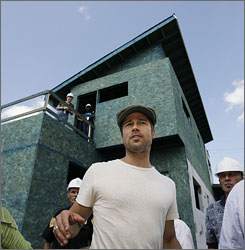 City on the mend: Brad Pitt visits an environmentally friendly construction project Tuesday in the devastated  Lower Ninth Ward of New Orleans.
