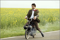 Ooh la la!: Mr. Bean (Rowan Atkinson) rides around France.