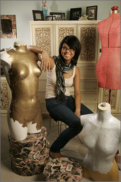 Gift of thrift: Trixie Encomienda, 17, a student at the California Design College in Los Angeles, shows off some of the furnishings and interior design items that she has bought at thrift stores.