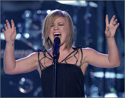 Kelly Clarkson, here performing at the Teen Choice Awards on Aug 26, will restart her tour Oct. 14.