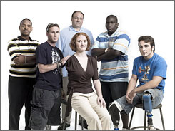 A little-seen side of war: The Sopranos' James Gandolfini, third from left, with some of the wounded Iraq war veterans who are featured in the HBO documentary Alive Day Memories: Jay Wilkerson, left, Bryan Anderson, Dawn Halfaker, Dexter Pitts and Jonathan Bartlett.