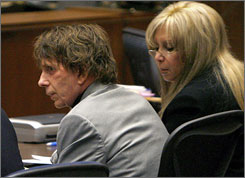 Phil Spector and defense attorney Linda Kenny Baden listen to the prosecution's closing argument in Los Angeles on Wednesday.