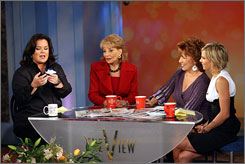 Rosie's view: Rosie O'Donnell, left, with Barbara Walters, Joy Behar and Elisabeth Hasselbeck, still has something to say in her book Celebrity Detox.