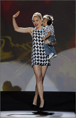 Mom and son: Gwen Stefani and Kingston wave to the crowd on the catwalk after the L.A.M.B. show.
