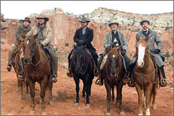 Man in black: Russell Crowe plays the bad guy bound for prison. Along for the ride: Alan Tudyk, left, Christian Bale, Peter Fonda and Dallas Roberts.