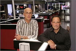 "On with the show: TMZ, with Jim Paratore, left, and Harvey Levin, is based in TMZ.com's newsroom. Like the website, the TV version will show ""the real Hollywood,"" Levin says."