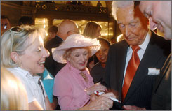 Bob Barker signs autographs after being inducted into the Hall of Famous Missourians on Wednesday.