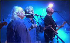  David Crosby, left, and Graham Nash sing with David Gilmour on Shine On You Crazy Diamond on the DVD. 