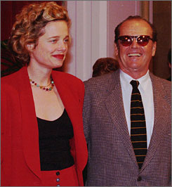 Rebecca Broussard, seen here at a 1998 Oscar luncheon with Jack Nicholson, pleaded innocent in her drunken driving case. She was arrested following a collision on Aug. 26.
