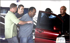 O.J. Simpson is transferred to Clark County Detention Center by Las Vegas police following his arrest on Sunday.