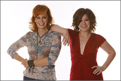 Mutually beneficial: Reba McEntire, left, and Kelly Clarkson have a hit on Reba Duets.