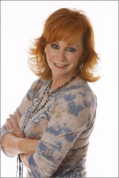 Y'all come: Country star Reba McEntire's new album, Reba Duets, features contributions from a wide range of artists.