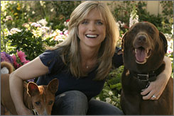 Unleashed: Courtney Thorne-Smith and her dogs, Ed, left, and Norman. The actress, 39, has written her first novel, Outside In.