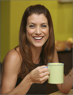 New beginnings: Kate Walsh was married Sept. 1 and launches her Grey's Anatomy spinoff, Private Practice, on Wednesday. The show, set in a hip medical center, has a flirty vibe  on and off the set.
