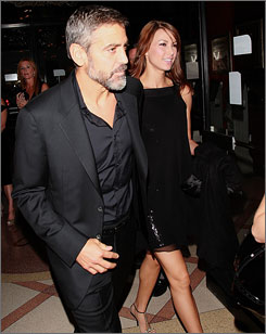 George Clooney and Sarah Larson arrive at the premiere ofThe Assassination Of Jesse James By The Coward Robert Ford at New York's Ziegfeld Theater on Tuesday. The two were in a motorcycle accident on Friday.