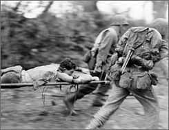 Sacrifice and honor: In a scene from Ken Burns' The War, soldiers evacuate the wounded in Okinawa in 1945, where the last battle of World War II took place.