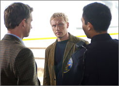 Accidental time traveler: Kevin McKidd, shown with Reed Diamond, left, plays Dan.