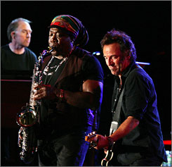 Jersey boys: Bruce Springsteen, right, accompanies Danny Federici, left, and Clarence Clemons on Monday, the first of two benefit concerts.