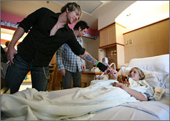 Room service: Joe Don Rooney, left, and Jay DeMarcus greet patient Kayla Curry, 12, of Hendersonville, Tenn., at Monroe Carell Jr. Children's Hospital at Vanderbilt University in Nashville after their performance.