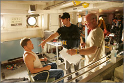Director Tony Scott, far right, works on a scene with Dylan Bruno, left, and Rob Morrow on the Numb3rs set.