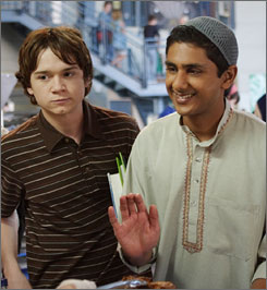 Just a normal kid: Adhir Kalyan, right, plays a Muslim exchange student who lives with Dan Byrd, left, and his family in CW's Aliens in America.