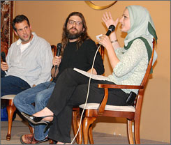 Alien ideas: Moses Port, left, and David Guarascio with Edina Lekovic of the Muslim Public Affairs Council at a screening of their CW series.