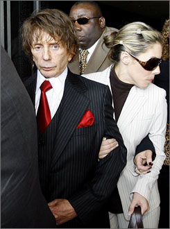 Phil Spector and his wife Rachelle leave court on Sept. 26 after a mistrial was declared in his murder case.