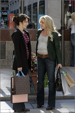 Shop talk: Tina Fey, left, and Jane Krakowski are 30 Rock regulars. They'll be joined by stars such as Jerry Seinfeld and Edie Falco this season.