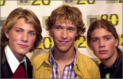 Taylor, Isaac and Zachary Hanson attend the MTV: Music Television's 20th anniversary celebration in 2001.