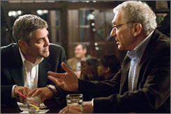 Thriller for adults: Attorney Michael Clayton (George Clooney), left, and senior law partner Marty Bach (Sydney Pollack) are in a fix and know it.