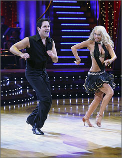 "On the beat: Mark Cuban does the mambo with Kym Johnson on Week 2 of Dancing With the Stars. He had hip replacement shortly before starting rehearsals, and now, ""I feel like I'm 21."""